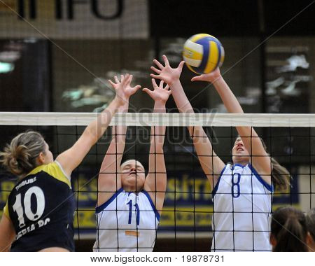 KAPOSVAR, HUNGARY - JANUARY 17: Petras (10), Palfy (11) and Kondor T. (8) in action at the Hungarian NB I. League woman volleyball game Kaposvar vs Eger, January 17, 2010 in Kaposvar, Hungary.
