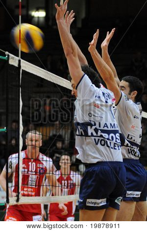 KAPOSVAR, HUNGARY - JANUARY 22: Hoboth (C) and Nagy (R) blocks the ball at a Middle European League volleyball game Kaposvar (HUN) vs. HotVolleys Wien (AUT), January 22, 2010 in Kaposvar, Hungary.