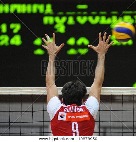 KAPOSVAR, HUNGARY - JANUARY 22: Guilherme blocks the ball at a Middle European League volleyball game Kaposvar (HUN) vs. HotVolleys Wien (AUT), January 22, 2010 in Kaposvar, Hungary.