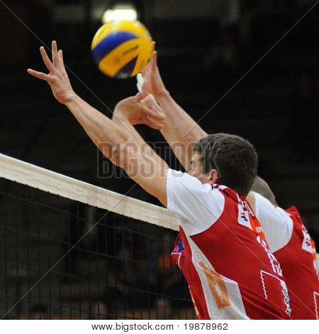 KAPOSVAR, HUNGARY - JANUARY 22: Unidentified players blocks the ball at a Middle European League volleyball game Kaposvar (HUN) vs. HotVolleys Wien (AUT), January 22, 2010 in Kaposvar, Hungary.