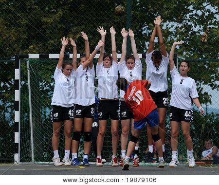 FONYOD, HUNGARY - AUGUST 22: Unidentified players in action at the VIII Balaton Cup International Youth Handball Tournament match Siofok vs. Kadarkut - August 22, 2009 in Fonyod, Hungary.