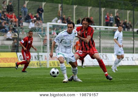 KAPOSVAR, HUNGARY - MAY 5: Lorant Olah (in white) in action at a Hungarian National Championship soccer game Kaposvar vs Budapest Honved May 5, 2008 in Kaposvar, Hungary.