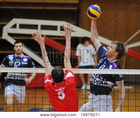 KAPOSVAR, HUNGARY - JANUARY 31: Colic (C) and Kovacs (R) in action at a Middle European League volleyball game Kaposvar (HUN) vs. Mladost Zagreb (CRO), January 31, 2010 in Kaposvar, Hungary.