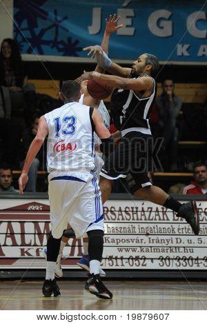 KAPOSVAR, HUNGARY - FEBRUARY 10: Rahsaan Ames (R) in action at a Hungarian National Cup basketball game between Kaposvar and Pecsi VSK February 10, 2010 in Kaposvar, Hungary.