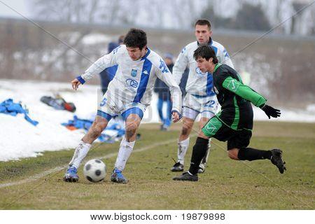 KAPOSVAR, HUNGARY - FEBRUARY 20: Lukacs Bole (r) in action at a friendly soccer game with Kaposvar (HUN) vs NK Osijek (CRO) February 20, 2010 in Kaposvar, Hungary.