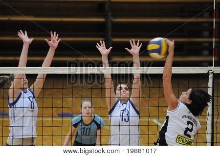 KAPOSVAR, HUNGARY - MARCH 13: T. Kondor (L) and G. Kondor (2nd R) in action at the Hungarian NB I. League woman volleyball game Kaposvar vs Veszprem, March 13, 2010 in Kaposvar, Hungary.