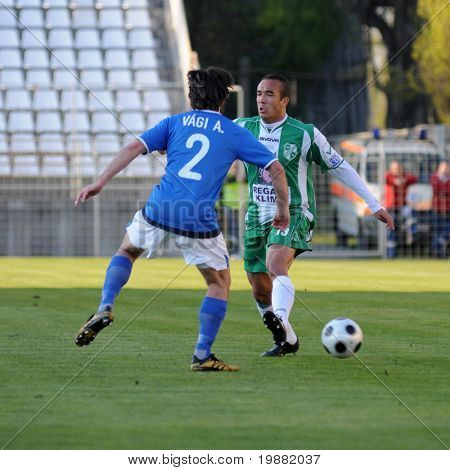 KAPOSVAR, HUNGARY - APRIL 17: Vagi (L) and Junior (R) in action at a Hungarian National Championship soccer game Kaposvar vs MTK Budapest April 17, 2010 in Kaposvar, Hungary.