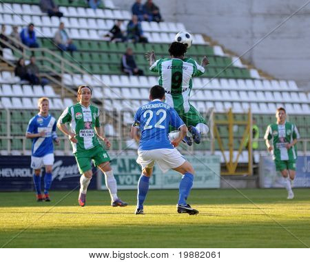 KAPOSVAR, HUNGARY - APRIL 17: Egejuru (9) heads the ball at a Hungarian National Championship soccer game Kaposvar vs MTK Budapest April 17, 2010 in Kaposvar, Hungary.