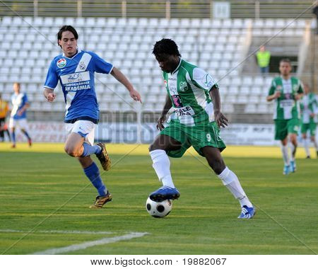 KAPOSVAR, HUNGARY - APRIL 17: Egejuru Godslove (R) in action at a Hungarian National Championship soccer game Kaposvar vs MTK Budapest April 17, 2010 in Kaposvar, Hungary.