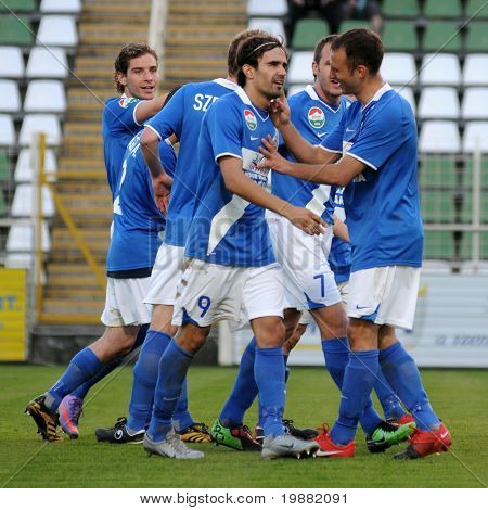 KAPOSVAR, HUNGARY - APRIL 17: MTK players celebrate a goal at a Hungarian National Championship soccer game Kaposvar vs MTK Budapest April 17, 2010 in Kaposvar, Hungary.