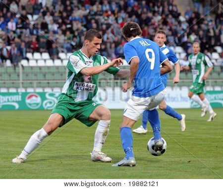 KAPOSVAR, HUNGARY - APRIL 17: Gruz (L) and Pal (R) in action at a Hungarian National Championship soccer game Kaposvar vs MTK Budapest April 17, 2010 in Kaposvar, Hungary.