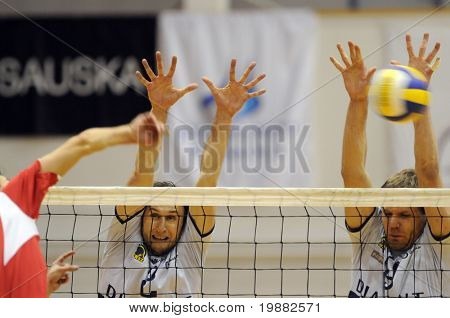 KECSKEMET, HUNGARY - APRIL 27: Koch (L) and Kovacs (R) blocks the ball at a Hungarian National Championship Final volleyball game Kecskemet vs. Kaposvar, April 27, 2010 in Kecskemet, Hungary.