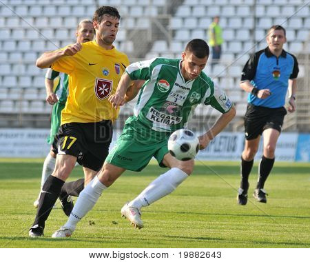 KAPOSVAR, HUNGARY - MAY 1: Nikolic (17) and Gruz (C) in action at a Hungarian National Championship soccer game Kaposvar vs. Videoton May 1, 2010 in Kaposvar, Hungary.