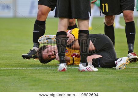 KAPOSVAR, HUNGARY - MAY 1: Balazs Farkas complains of a pain in his foot at a Hungarian National Championship soccer game Kaposvar vs. Videoton May 1, 2010 in Kaposvar, Hungary.