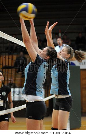 KAPOSVAR, HUNGARY - APRIL 13: G. Kondor (C) and T. Kondor (R) blocks the ball at the Hungarian NB I. League woman volleyball game Kaposvar vs Miskolc, April 13, 2010 in Kaposvar, Hungary.