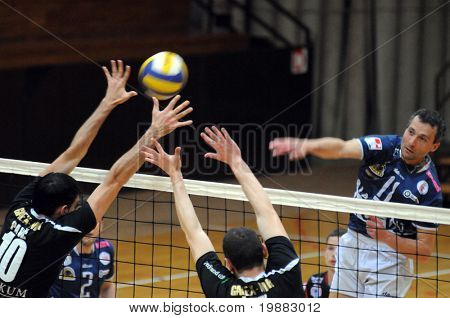 KAPOSVAR, HUNGARY - APRIL 7: Sandor Kantor (R) stirkes the ball at a friendly volleyball game Kaposvar (HUN) vs. Murska Sobota (SLO), April 7, 2010 in Kaposvar, Hungary.
