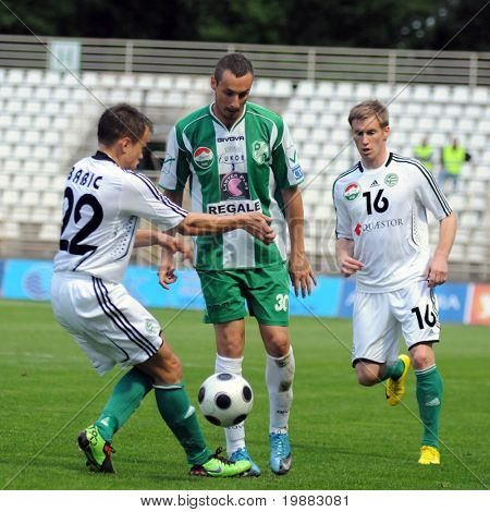 KAPOSVAR, HUNGARY - MAY 8: Babic (L), Stanic (C) and Kink (R) in action at a Hungarian National Championship soccer game Kaposvar vs. Gyor - May 8, 2010 in Kaposvar, Hungary.