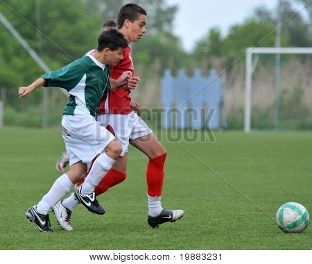 KAPOSVAR, HUNGARY - MAY 9: Weimann (ing red) and Gyorgy (in red) in action at the Hungarian National Championship under 15 game Kaposvari Rakoczi vs. Nagykanizsa May 9, 2010 in Kaposvar, Hungary.