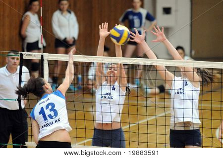 KAPOSVAR, HUNGARY - MARCH 21: Czmerk (C) and T. Kondor (R) blocks the ball at the Hungarian NB I. League woman volleyball game Kaposvar vs. Eger, March 21, 2010 in Kaposvar, Hungary.