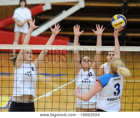 KAPOSVAR, HUNGARY - MARCH 21: T. Kondor (L)and G. Kondor (C) blocks the ball at the Hungarian NB I. League woman volleyball game Kaposvar vs. Eger, March 21, 2010 in Kaposvar, Hungary.