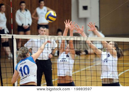 KAPOSVAR, HUNGARY - MARCH 21: Ihasz (C) and T. Kondor (R) blocks the ball at the Hungarian NB I. League woman volleyball game Kaposvar vs. Eger, March 21, 2010 in Kaposvar, Hungary.
