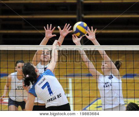 KAPOSVAR, HUNGARY - MARCH 21: Rebeka Rak (R) blocks the ball at the Hungarian NB I. League woman volleyball game Kaposvar vs. Eger, March 21, 2010 in Kaposvar, Hungary.