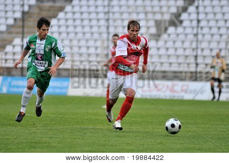 KAPOSVAR, HUNGARY - MAY 20: Bole (L) and Zsivoczky (R) in action at a Hungarian National Championship soccer game Kaposvar vs. Diosgyor - May 20, 2010 in Kaposvar, Hungary.