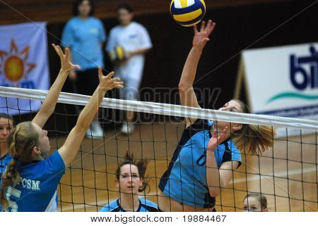 KAPOSVAR, HUNGARY - FEBRUARY 20: Timea Kondor (R) strikes the ball at the Hungarian Cup woman volleyball game Kaposvar vs. BSE, February 20, 2008 in Kaposvar, Hungary.
