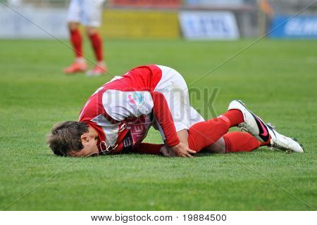 KAPOSVAR, HUNGARY - MAY 20: Zsivoczky complains of a pain in his foot at a Hungarian National Championship soccer game Kaposvar vs. Diosgyor - May 20, 2010 in Kaposvar, Hungary.