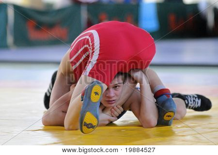 KAPOSVAR, HUNGARY - APRIL 17: Unidentified competitors wrestle in the Hungarian Wrestling Cadet National Championship , April 17, 2010 in Kaposvar, Hungary.