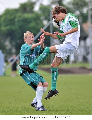 KAPOSVAR, HUNGARY - MAY 29: Krisztian Nagy (L) in action at the Hungarian National Championship under 15 game between Kaposvari Rakoczi and Paks May 29, 2010 in Kaposvar, Hungary.
