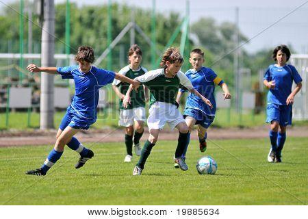 KAPOSVAR, HUNGARY - JUNE 12: Armin Prukner (C) in action at the Hungarian National Championship under 13 game between Kaposvari Rakoczi and Tatabanya June 12, 2010 in Kaposvar, Hungary.