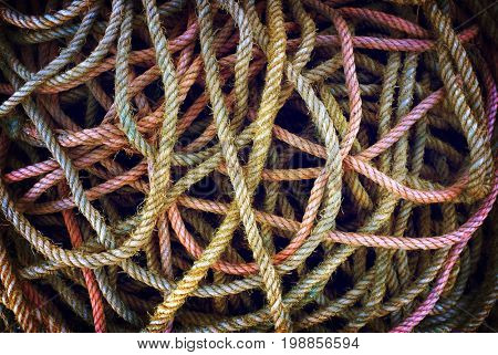 Colorful and messy pile of worn fishing ropes