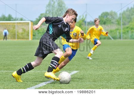 KAPOSVAR, HUNGARY - JUNE 5: Balint Hujbert (in black) in action at the Hungarian National Championship under 13 game between Kaposvari Rakoczi and Siofok B June 5, 2010 in Kaposvar, Hungary.