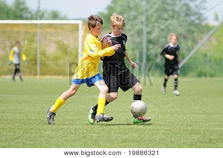 KAPOSVAR, HUNGARY - JUNE 5: David Gazder (R) in action at the Hungarian National Championship under 13 game between Kaposvari Rakoczi and Siofok B June 5, 2010 in Kaposvar, Hungary.