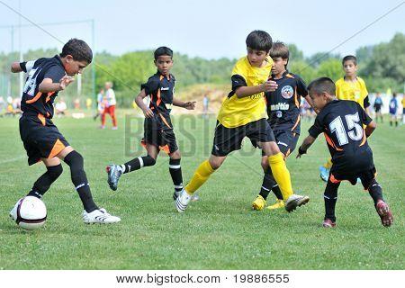 KAPOSVAR, HUNGARY - JULY 19: Unidentified players in action at a VI. Youth Football Festival match Efthymiades FA (CYP) vs. Academia Venezolana de Futbol (VEN)- July 19, 2010 in Kaposvar, Hungary