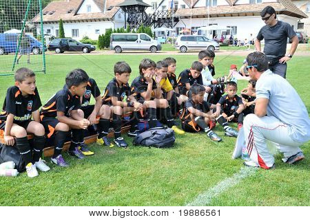 KAPOSVAR, HUNGARY - JULY 19: Venezuelan players listen to their trainer at a VI. Youth Football Festival match Efthymiades FA (CYP) vs. Academia Venezolana (VEN)- July 19, 2010 in Kaposvar, Hungary