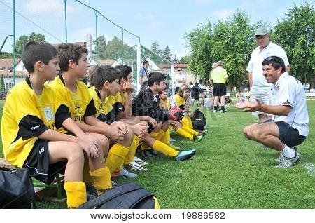 KAPOSVAR, HUNGARY - JULY 19: The Cyprian players listen to their trainer at a VI. Youth Football Festival match Efthymiades FA (CYP) vs. Academia Venezolana (VEN)- July 19, 2010 in Kaposvar, Hungary