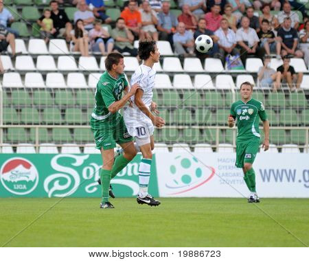 KAPOSVAR, HUNGARY - AUGUST 14: Robert Szepessy (in white) in action at a Hungarian National Championship soccer game Kaposvar vs. Haladas August 14, 2010 in Kaposvar, Hungary.