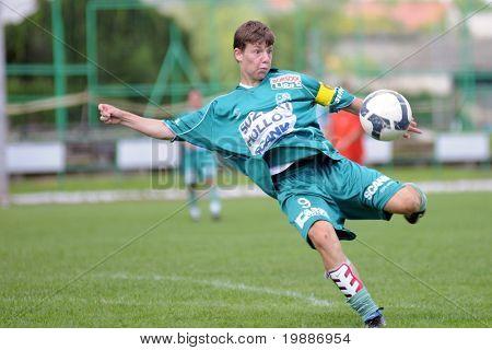 KAPOSVAR, HUNGARY - AUGUST 29: Richard Weimann in action at the Hungarian National Championship under 19 game between Kaposvari Rakoczi and Bonyhad August 29, 2010 in Kaposvar, Hungary.