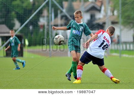 KAPOSVAR, HUNGARY - SEPTEMBER 4: Akos Veto (L) in action at the Hungarian National Championship under 13 game between Kaposvari Rakoczi and Barcs September 4, 2010 in Kaposvar, Hungary.
