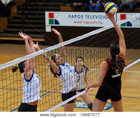 KAPOSVAR, HUNGARY - JANUARY 28: Barbara Balajcza (2nd from L) blocks the ball at the Hungarian Extra League woman volleyball game Kaposvar vs Godollo, January 28, 2007 in Kaposvar, Hungary.