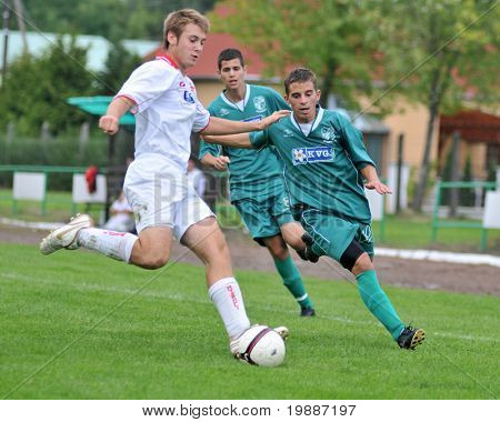 KAPOSVAR, HUNGARY - SEPTEMBER 4: Unidentified players in action at the Hungarian National Championship under 19 game between Kaposvari Rakoczi and Nyirsuli September 4, 2010 in Kaposvar, Hungary.
