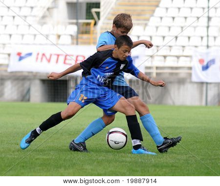 KAPOSVAR, HUNGARY - JULY 24: Unidentified players in action at the VI. Youth Football Festival Under 13 NK Dakovo (CRO) vs NK FK 7 Tuzla (BOS) July 24, 2010 in Kaposvar, Hungary