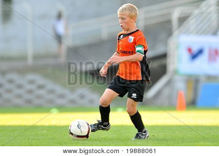 KAPOSVAR, HUNGARY - JULY 24: Unidentified player in action at the VI. Youth Football Festival Under 12 Final FK Novi Grad (BOS) vs. FK 7 Tuzla (BOS) July 24, 2010 in Kaposvar, Hungary
