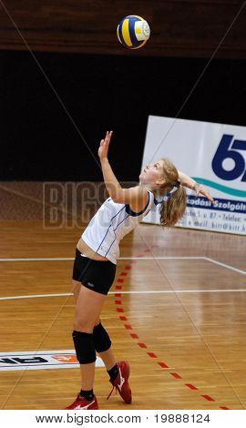 KAPOSVAR, HUNGARY - MAY 15: Timea Kondor serves the ball at the Hungarian Championship woman volleyball game Kaposvar vs. Miskolc, May 15, 2007 in Kaposvar, Hungary.