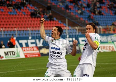 SZEKESFEHERVAR, HUNGARY - MARCH 17: Alves (L) and Zahorecz (R) celebrate a goal at a Hungarian National Championship soccer game Kaposvar vs. FC Fehervar March 17, 2007 in Szekesfehervar, Hungary