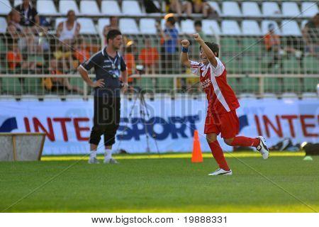 KAPOSVAR, HUNGARY - JULY 23: Unidentified player celebrates a goal at the VI. Youth Football Festival Under 11 Final FK Novi Grad (BOS) vs. Atletico Rosiori (ROM) July 23, 2010 in Kaposvar, Hungary
