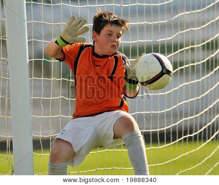 KAPOSVAR, HUNGARY - JULY 23: Unidentified player in action at the VI. Youth Football Festival Under 11 Final FK Novi Grad (BOS) vs. Atletico Rosiori (ROM) July 23, 2010 in Kaposvar, Hungary