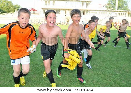 KAPOSVAR, HUNGARY - JULY 23: Bosnian players celebrate after the VI. Youth Football Festival Under 11 Final FK Novi Grad (BOS) vs. Atletico Rosiori (ROM) July 23, 2010 in Kaposvar, Hungary